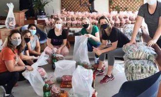 MÃO DADAS : A prática do bem através  das doações na periferia